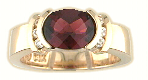 oval cut garnet and diamond ring